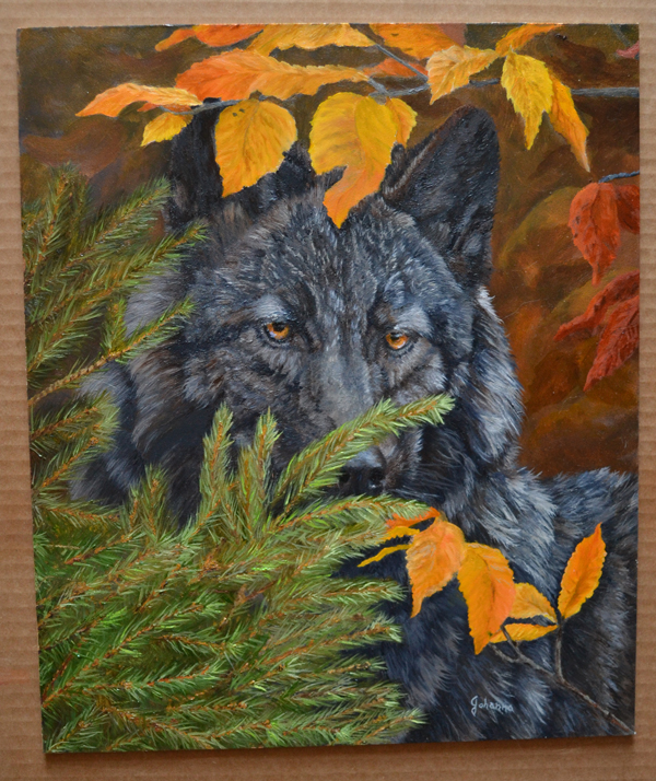 Painting in progress of a black wolf,